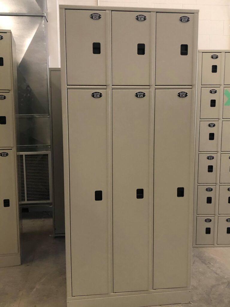 Photo of a light grey large steel locker with 6 compartments. This image is being presented to advertise the sale of this item as a municipal surplus equipment.