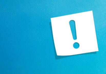 Exclamation mark on post-it note